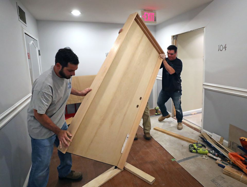 New England Soundproofing employees installed a heavyweight sound-deadening door for Andrew Hassey of the North End.