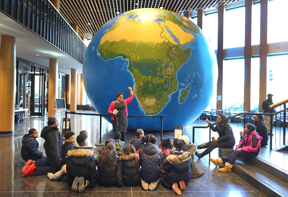 Natacha Scott used this inflatable globe on display at Boston Public School headquarters on Thursday to explain the size of countries to students from The Nathan Hale School.