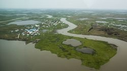 Newtok, Alaska, as seen from a plane in 2015 in Newtok, Alaska. A replacement village called Mertavik is slowly taking shape nine miles away.