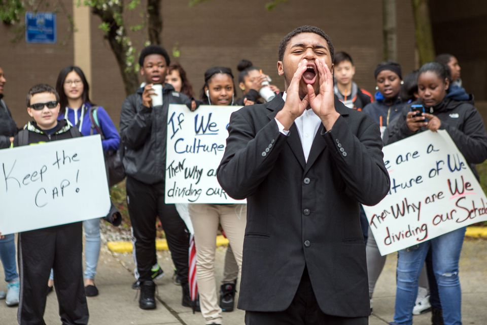 Student Vicktor Williams-Barros, 14, started a chant outside the Richard J. Murphy School in Dorchester Wednesday.