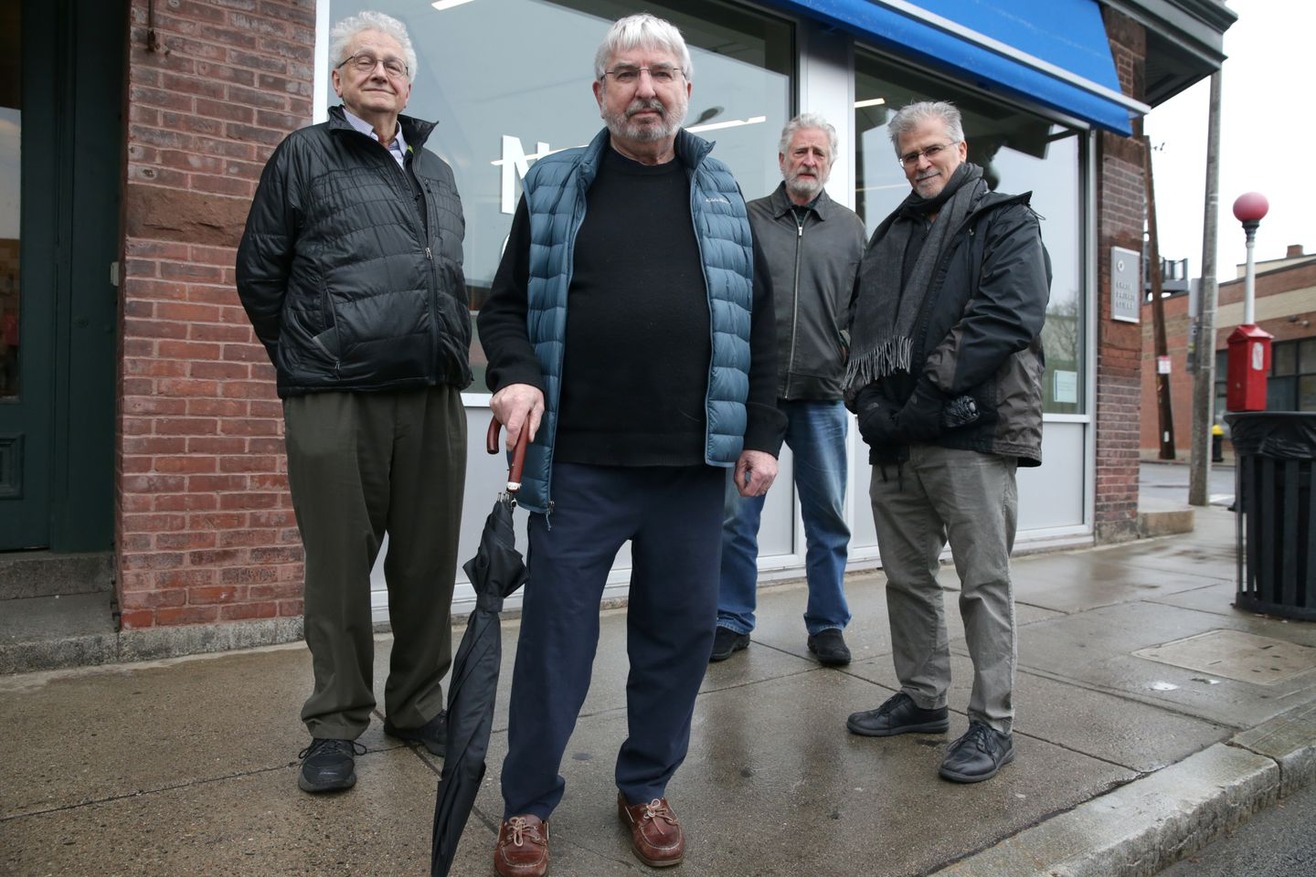 Jamaica Plain residents (from left) Gert Thorn, Kevin Moloney, Michael Epp, and and Ed Forte worked together to persuade Chase to alter the design of a new bank branch.
