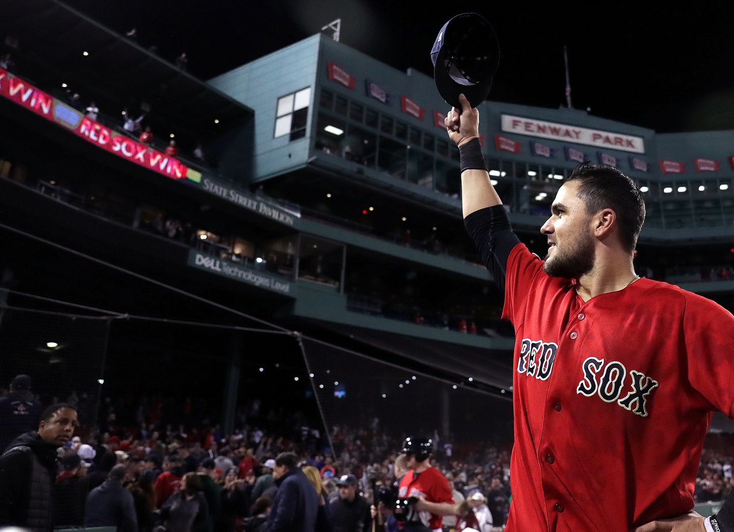 "Red Sox third baseman Michael Chavis (23) pulls his cap to the fans after his shot in the 10th inning. ""That's what all kids dream about, honestly,"" he said."
