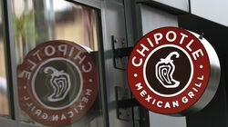 A Chipotle Mexican Grill sign in the Brooklyn borough of New York City. The fast-casual restaurant chain, which has 64 locations in Massachusetts, said last month that it would increase its average pay to $15 per hour nationally by the end of June.