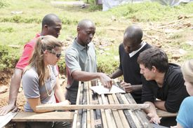 MASS Design fellows Sarah Mohland and Christian Benimana, project manager Commode Dushimimana, local engineer Christian Uwinkindi, and fellows Ben Hartigan and Jennifer Gaugler discuss construction strategies in Rwanda in May 2012.