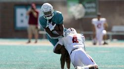 Coastal Carolina wide receiver Tyler Roberts is tackled by UMass defensive back Noah Boykin in the second half of the Chanticleers' victory.
