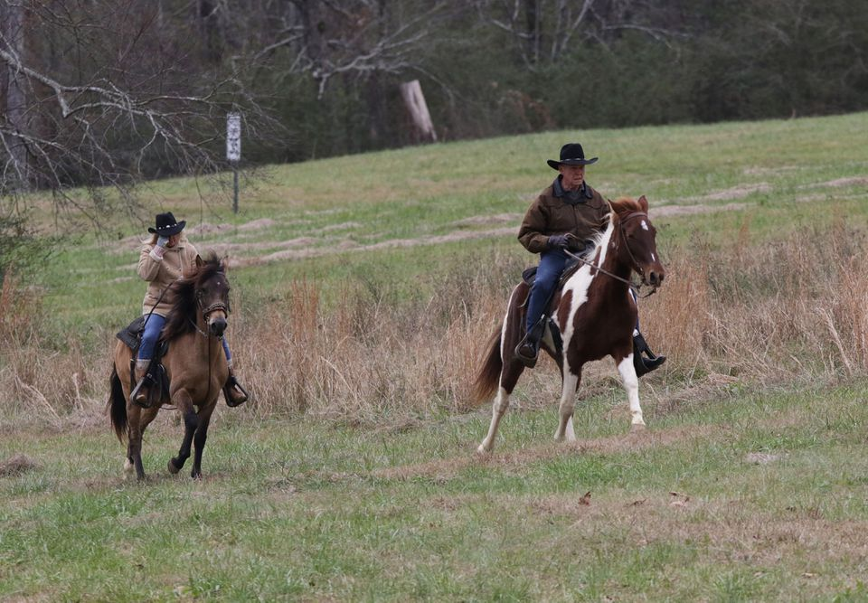 Kayla and Roy Moore rode on horseback to vote in Gallant, Ala.