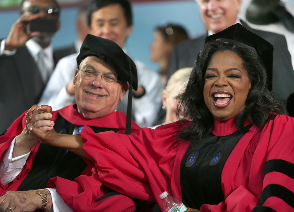 Thomas Menino sat with Oprah Winfrey at Harvard's graduation ceremony, where both received honorary doctorates.