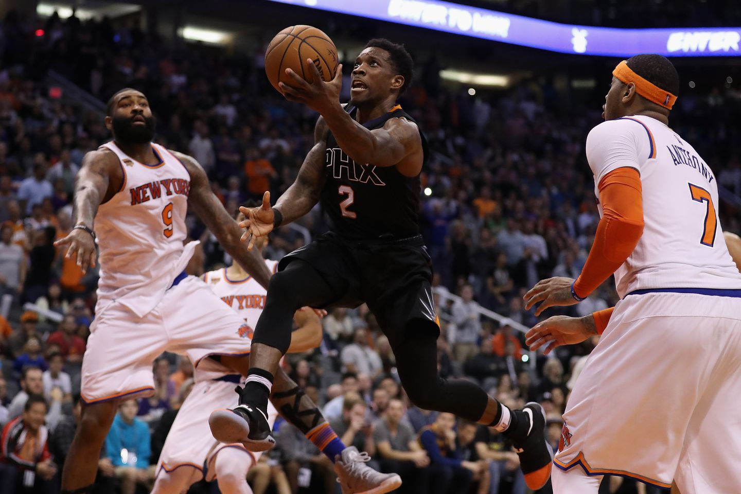 51897bf3608b Eric Bledsoe (2) of the Phoenix Suns laid up a shot past Carmelo Anthony