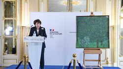 """French Culture Minister Roselyne Bachelot deliverseda speech next to the painting """"Rosebushes under the Trees"""" (1905) by Austrian painter Gustav Klimt, during an event to announce the restitution of the artwork to a Jewish family from which it had been despoiled in 1938."""