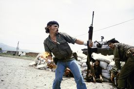 Taken in 1979, Susan Meiselas's photo shows a Sandinista fighter about to hurl a Molotov cocktail.