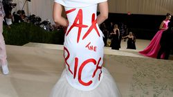 """Alexandria Ocasio-Cortez attended The 2021 Met Gala in a white gown designed by Aurora James, with """"Tax The Rich"""" emblazoned across the back, sparking a Twitter storm."""