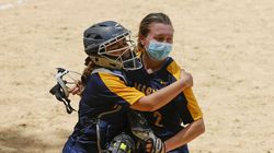 St. Mary's catcher Felicia D'Alessandro hugs pitcher Lily Newhall after they defeated Austin Prep in Saturday's Catholic Central League matchup.