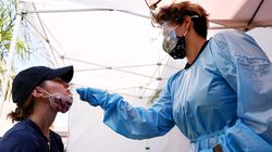 A medical assistant administers a COVID-19 test to a person at Sameday Testing on July 14, 2021 in Los Angeles, California.