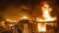 A house burns on Platina Road at the Zogg Fire near Ono, Calif. Pacific Gas & Electric has been charged with manslaughter and other crimes, Friday, Sept. 24, 2021, in a Northern California wildfire last year that killed four people and destroyed hundreds of homes.
