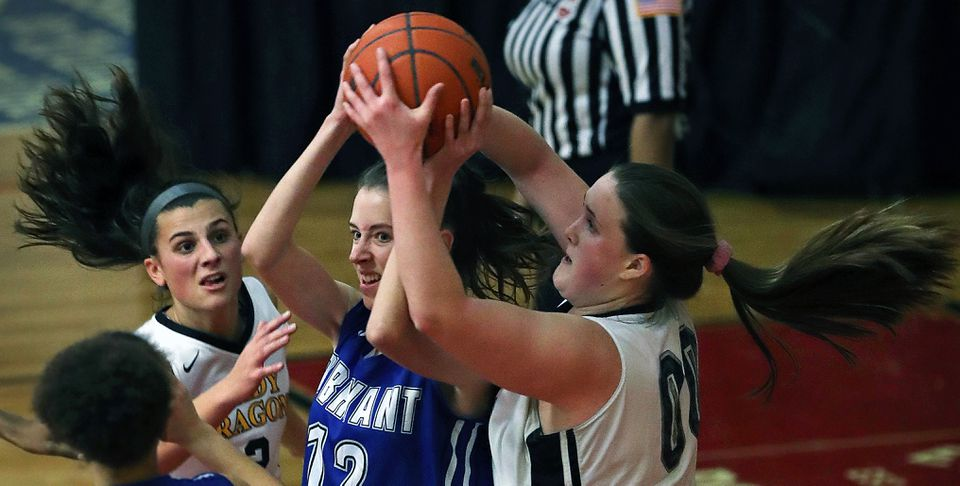 Latin Academy's Fiona Mannion (right) sneaks in and steals the ball right out of the hands of O'Bryant's McRae Wiederer (center). in Wednesday's Boston City League semifinal at Madison Park.