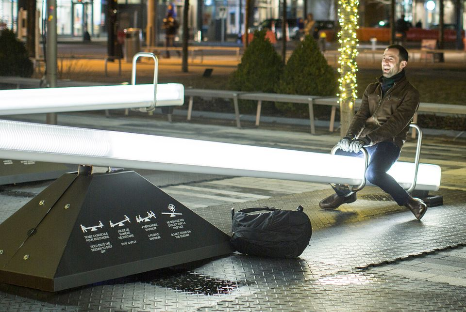 "An art installation in Boston titled ""Impulse"" allows passersby to ride a seesaw that generates musical tones."
