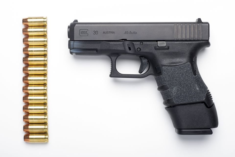 A Glock 30SF .45 Auto semi-automatic pistol with a Glock 13-round extension magazine installed, and 13 rounds of hollow-point ammunition.