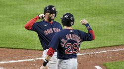 Xander Bogaerts (left) celebrates with Red Sox teammate J.D. Martinez (right) after hitting a two-run home run in the sixth inning of an 11-6 win over the host Baltimore Orioles on Saturday night.
