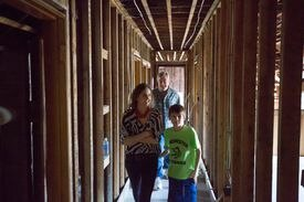 Jennifer Adams, her son Bennett,  and Winchester Historical Commission member Jack LeMenager tour a 1914 house under renovation at 7 Grove St.