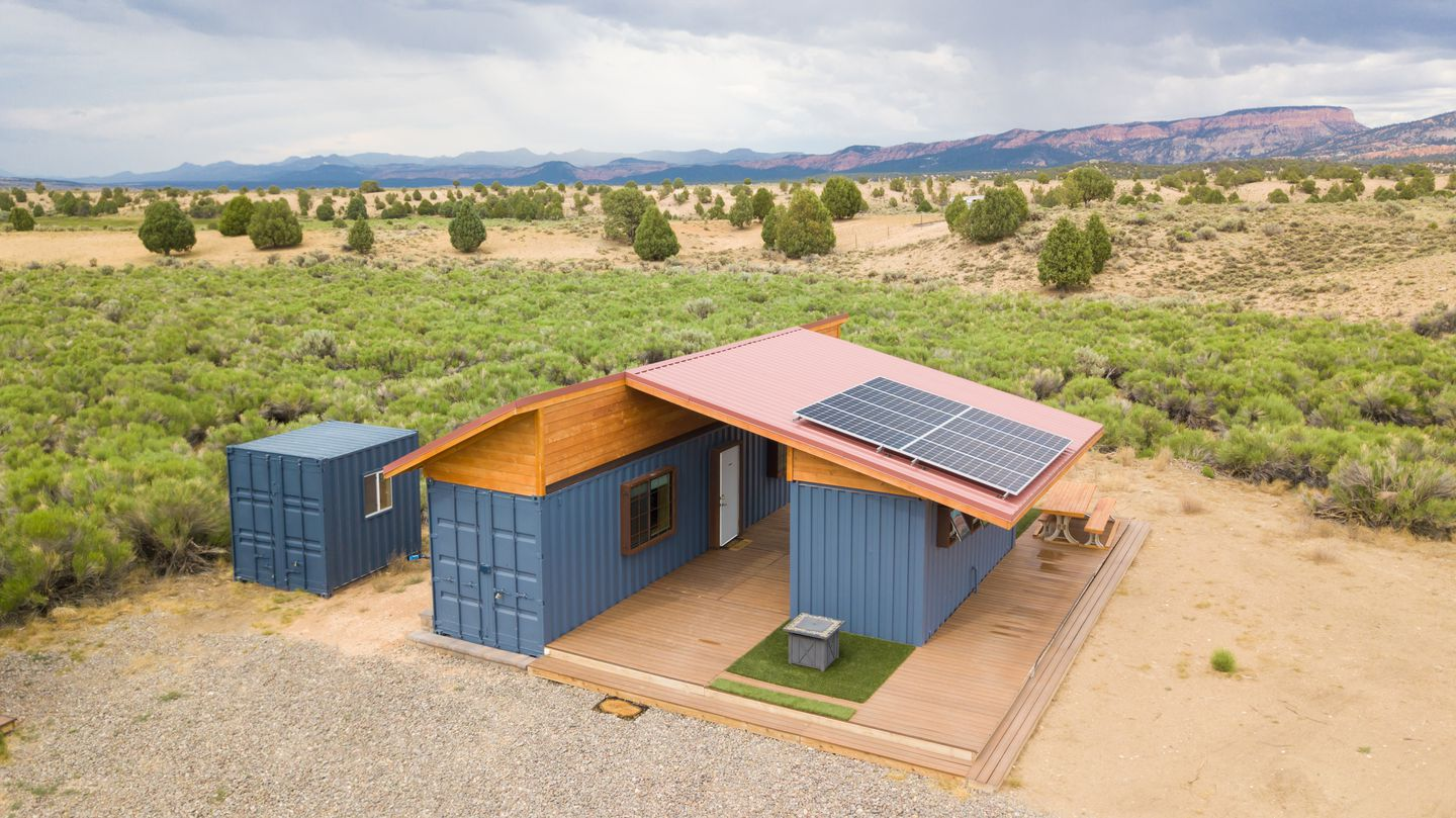 Sleep in huts with showers, lighting, solar power for charging devices, fire pits, and a fully stocked kitchen.
