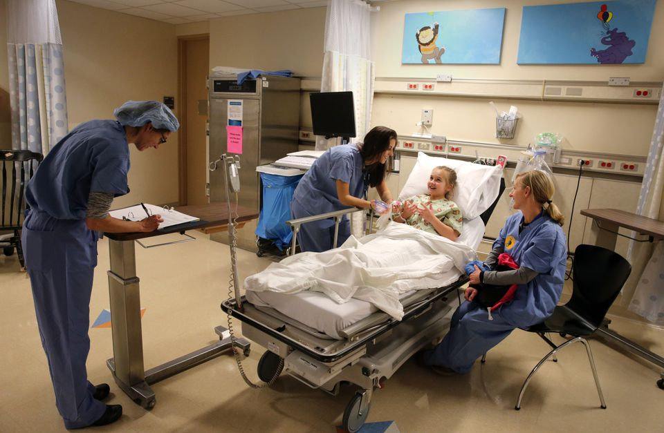Anesthesiologist Dr. Makara Cayer and child life specialist Brianna Peck talked with Mia Quinn, 11, and her mother Sheila Quinn.