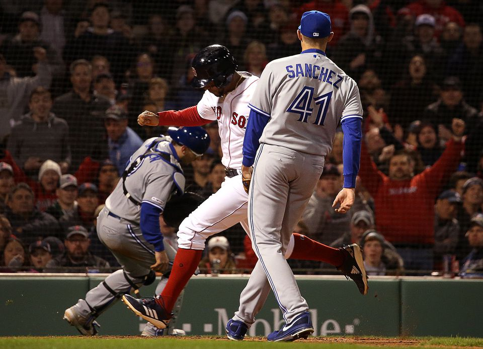 Shortstop Xander Bogaerts scores on a wild pitch to bring the Red Sox within a run of Toronto during the fifth inning.