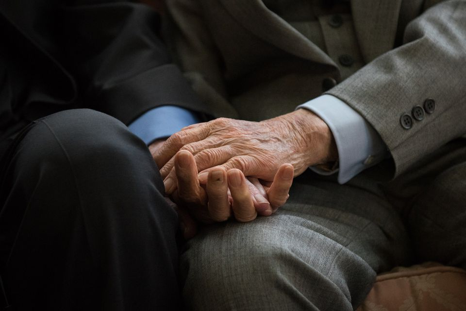 """World War II veterans, British former army captain Harold Atcherley (left), 96, and Japanese former army engineer Mikio Kinoshita (right), 94, held hands as they attended a reception in their honor in London in June. While held as a prisoner of war by the Imperial Japanese Army in 1943, Atcherley was forced to work on the infamous Burma-Thailand """"death railway,"""" a Japanese wartime project that cost the lives of an estimated 120,000 people. Kinoshita served as a Japanese army engineer, working on the same railway line."""