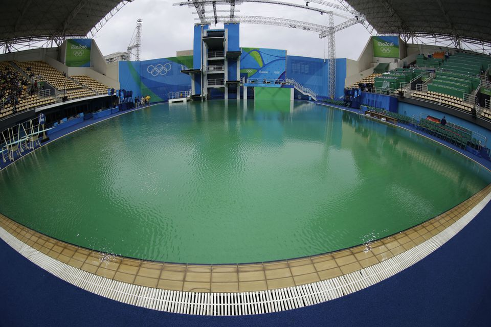 Green water in the diving pool was attributed to an overdose of hydrogen peroxide.