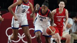 United States' Jewell Loyd (4), center, brought the ball upcourt during women's basketball preliminary round game against Japan.