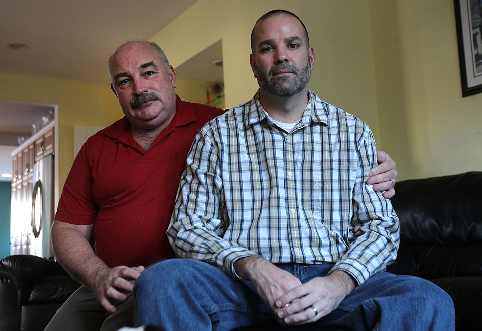 Matthew Barrett (right), with his husband, Ed Suplee, returned to a public schools job.