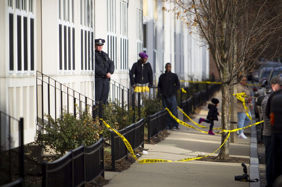 Authorities investigated the scene at 77 Lenox St. where Boston Police said officers shot and killed a man as they tried to arrest him.