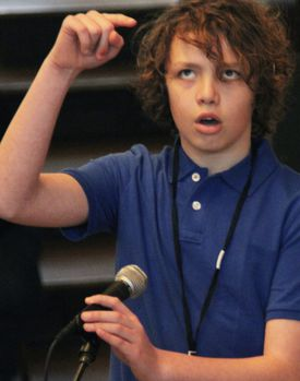 Sam Lowery took a turn at the microphone during the city's fifth annual Citywide Spelling Bee.