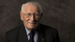 """In this undated photo provided by the Sydney Jewish Museum, Holocaust survivor Eddie Jaku poses for a photograph in Sydney, Australia. Jaku, who last year published his best-selling memoir, """"The Happiest Man on Earth,"""" has died in Sydney, a Jewish community leader said. He was 101."""