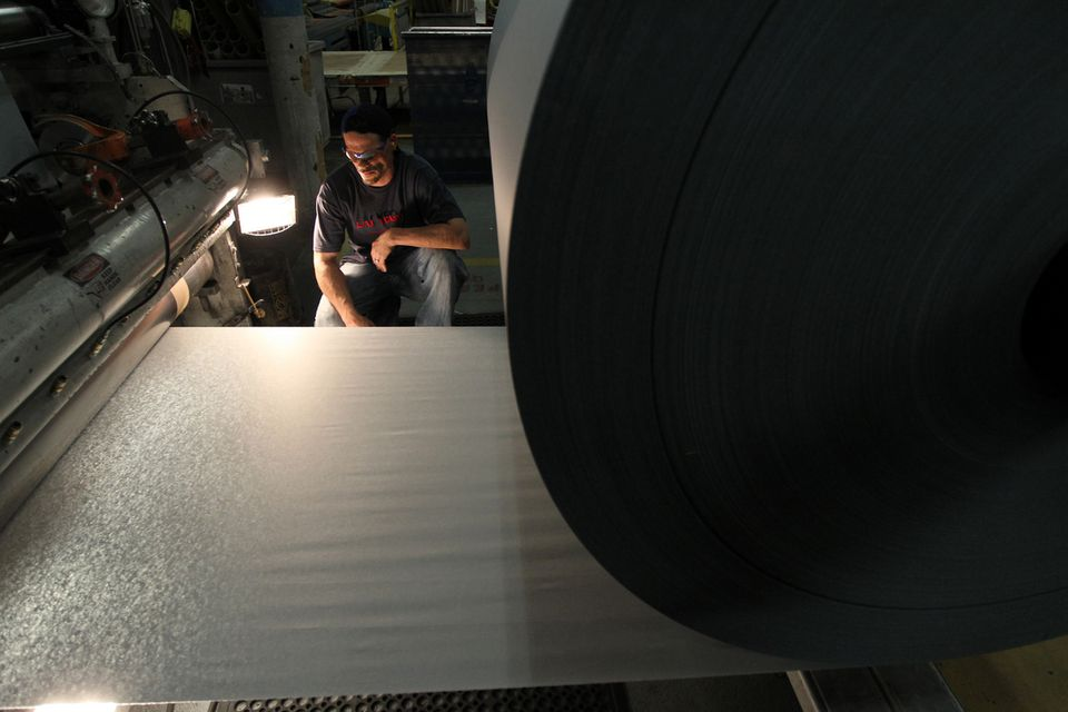 A worker inspected paper at Onyx Specialty Papers, a South Lee company that stands to gain from lower natural gas prices.