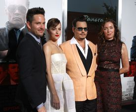 "Director Scott Cooper, Dakota Johnson, Johnny Depp and Julianne Nicholson were at the Boston premier of ""Black Mass."""