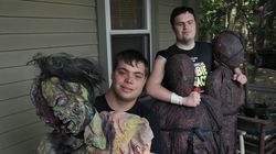Sam Suchmann, right, and Mattie Zufelt pose with ghoulish figures at Sam's home in Providence, R.I. The two young men with Down syndrome who caused a sensation four years ago when they created their own gory zombie movie are back, this time in a documentary championed by a Hollywood luminary.