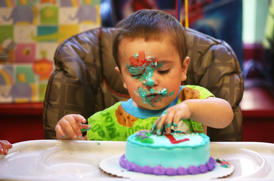 """Andre DeCorzo Jr. concentrated on his """"smash cake"""" during his birthday party at the Children's Museum of Fall River in October."""