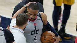 Washington head coach Scott Brooks and Russell Westbrook chat after Westbrook's 181st career triple-double brought the Wizards a needed victory and Westbrook even with Oscar Robertson's longstanding record.