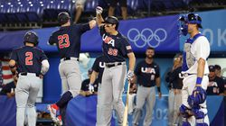 Red Sox prospect Triston Casas (26) congratulates Tyler Austin (23), who hit a two-run home run in Team USA's 8-1 victory over Israel.