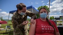 An employee receives a vaccination against Covid-19 from a National Guard soldier at a pop-up vaccination stand at the Vermont Creamery in Websterville, Vermont on June 29, 2021.