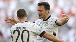 Robin Gosens celebrates with teammate Mats Hummels after scoring Germany's fourth goal during a 4-2 win over Portugal Saturday in a UEFA Euro 2020 Championship Group F match in Munich.