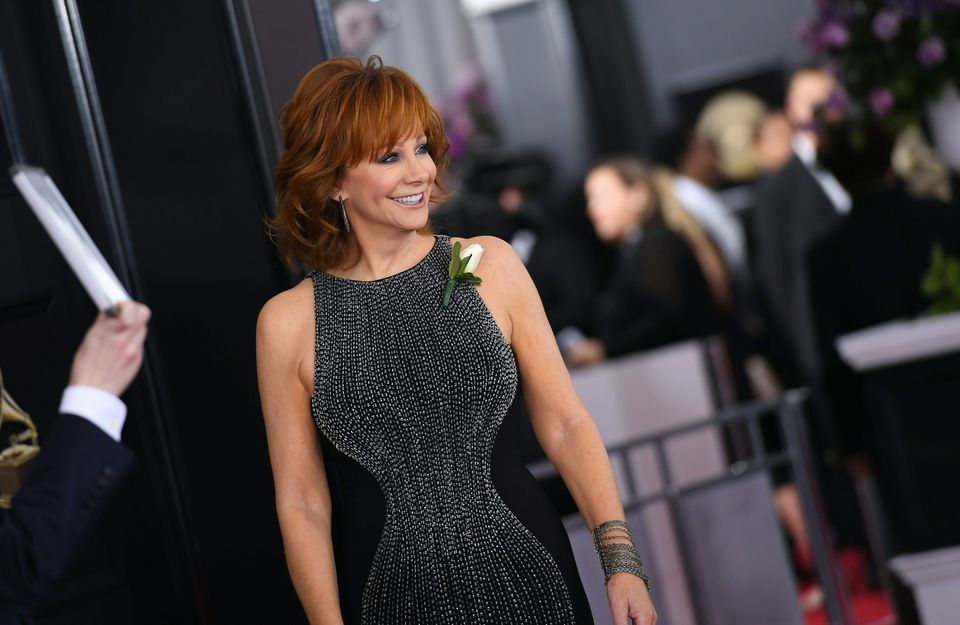Country star Reba McEntire wore a Jovani sleeveless studded gown in black with silver embellishment, with a white rose in place as a reminder to everybody to ''treat each other like we want to be treated. It's the golden rule.''