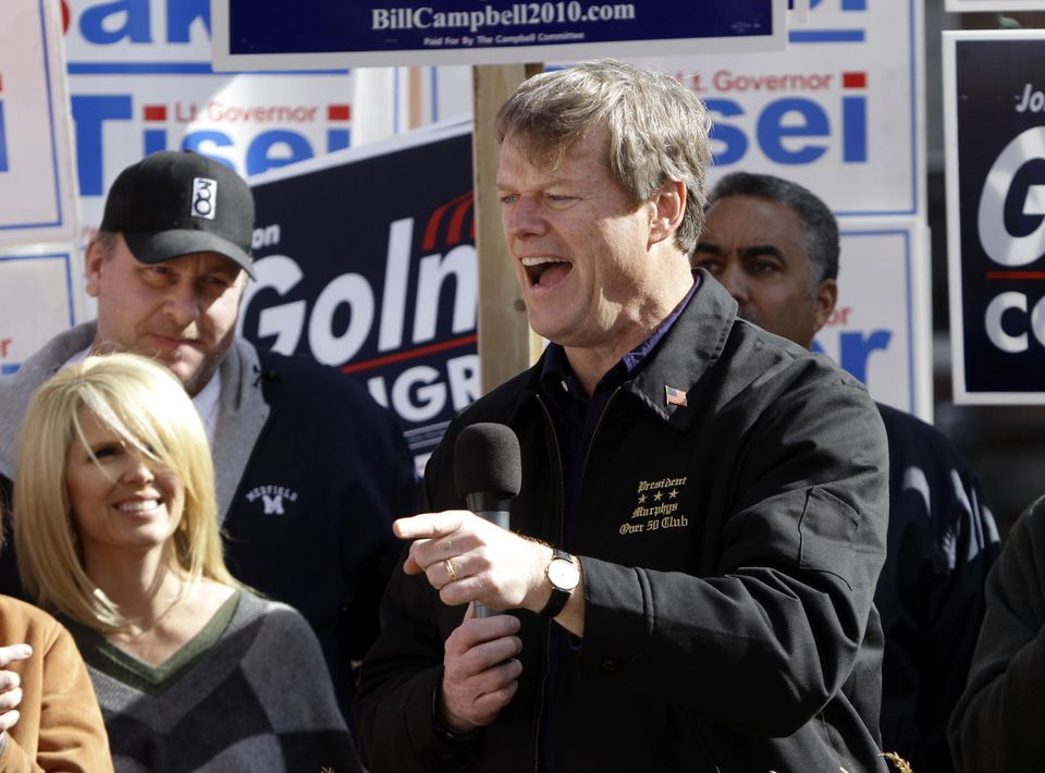 Republican gubernatorial candidate Charlie Baker, right, addressed an audience as former Boston Red Sox pitching ace Curt Schilling, left, looks on with his wife Shonda during a campaign stop in Haverhill in 2010.