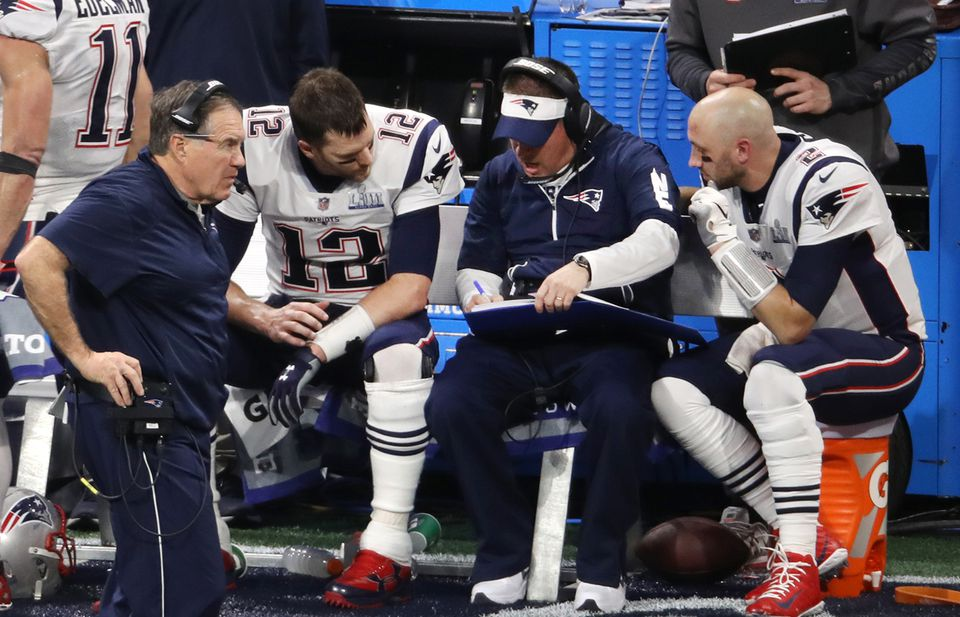 Josh McDaniels and Tom Brady brainstorm during the Patriots' victory over the Rams in the Super Bowl.