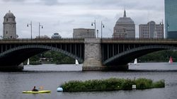 Max Rome paddled in a kayak to conduct research at a floating man-made wetland in the Charles River.
