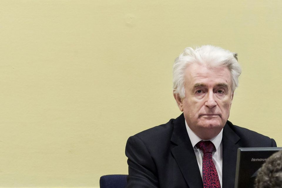 Former Bosnian Serb leader Radovan Karadzic waited for his sentence in court in The Hague.