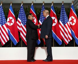 North Korean leader Kim Jong Un and President Trump shake hands prior to their meeting in Singapore on Tuesday, June 12.