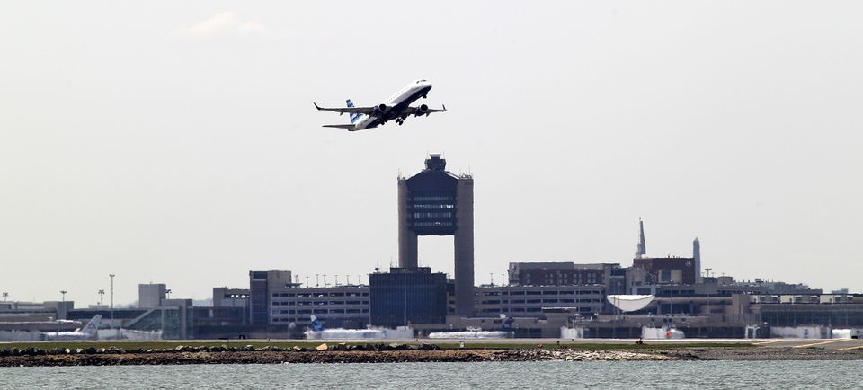 View from Deer Island of a passenger jet taking off from Logan Airport.