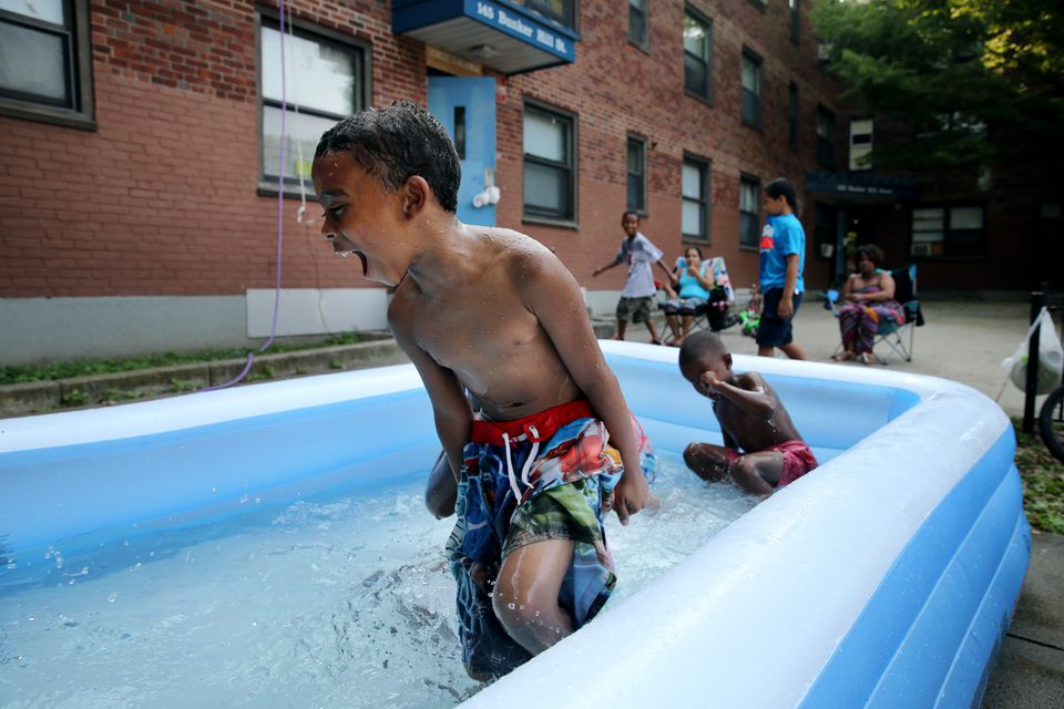 Arthur Hodges played in a pool at the Bunker Hill development in Charlestown last month.