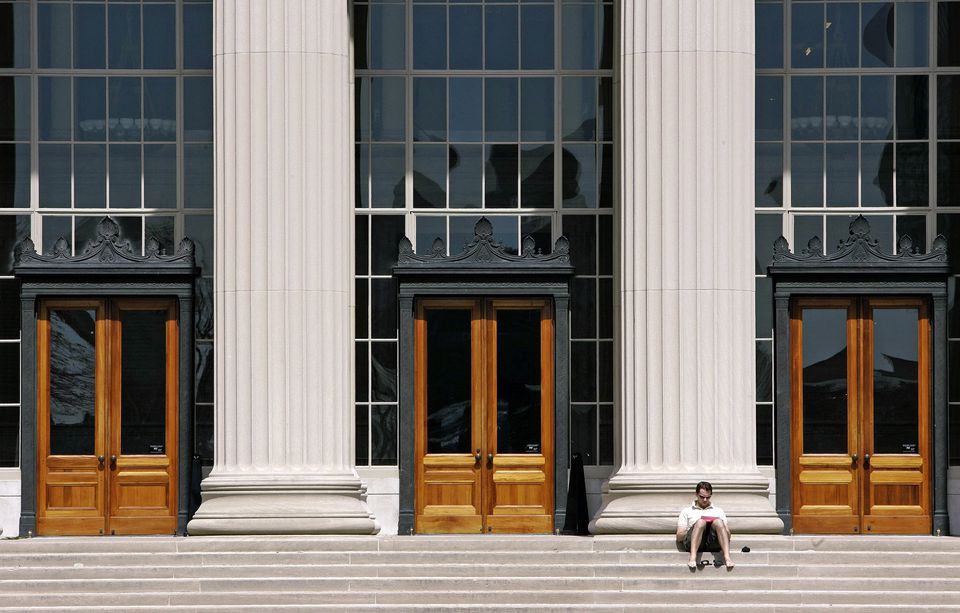 In this April 22, 2007 file photo, a doctoral student at the Massachusetts Institute of Technology reads outside a building at the Cambridge, Mass. campus